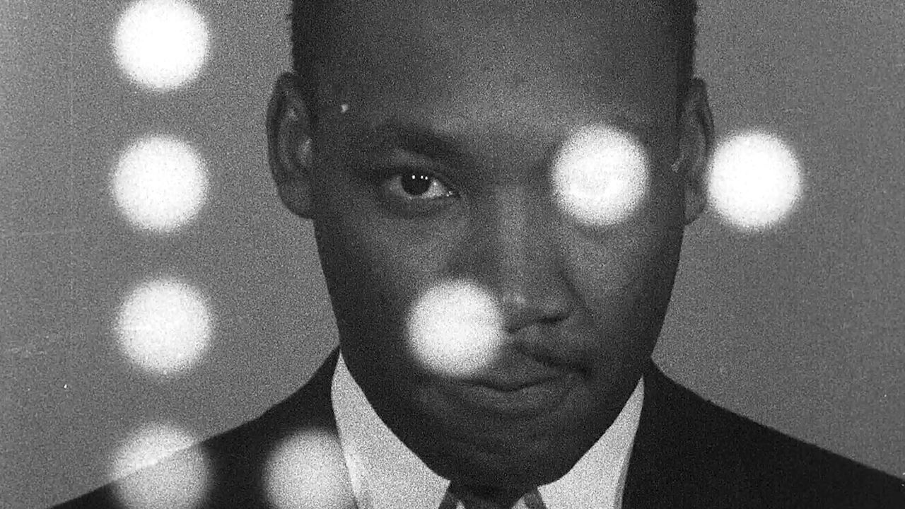 Headshot of Martin Luther King with lens flare distortion