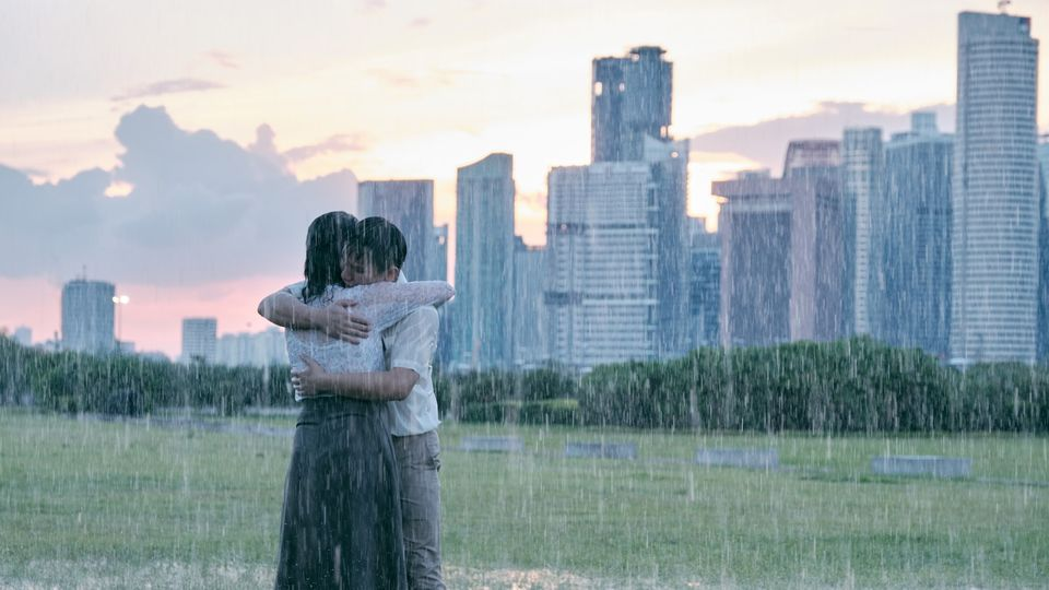 Two People Hug in Driving Rain